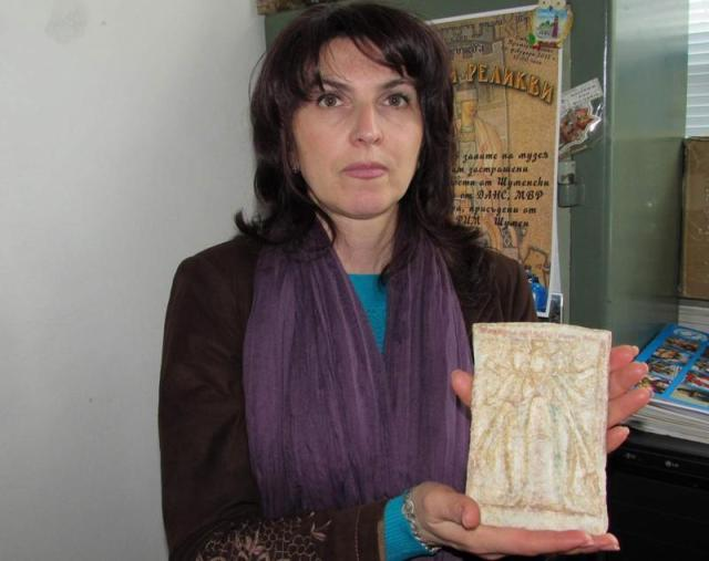 "Dr. Zhenya Zhekova, numismatist at the Shumen Regional Museum of History, shows the invaluable ancient marble plate with the image of the ""triple""Hecate, a Greek goddess. Photo by Dr. Zhenya Zhekova/Trud daily"