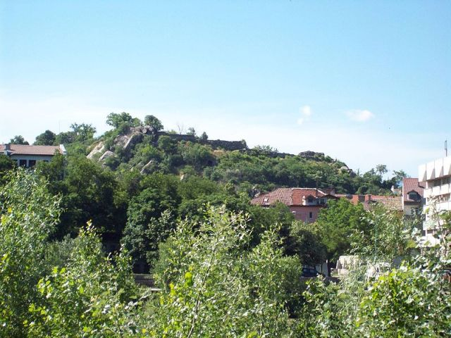 The prehistoric, ancient, and medieval settlement and fortress of the Nebet Tepe hill in Bulgaria's Plovdiv as viewed from the north. Photo by Peterdx, Wikipedia