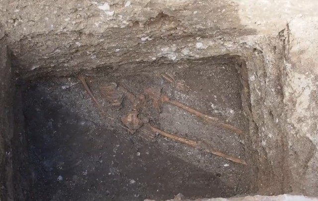 "The unearthed 4th-5th century AD skeleton of the tall man buried under the Odessos fortress wall has been lying ""in situ"" since it was found on March 17, 2015. Photo: TV grab from Nova TV"